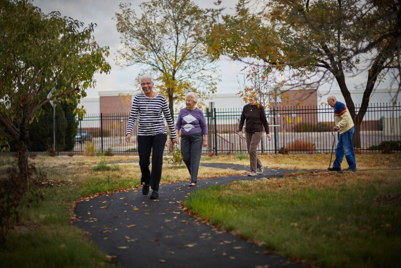 Seniors walking on senior living community path